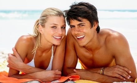 One or Two VersaSpa Sunless Spray Tans or Four UV Tans at Tan Me Inc (Up to 75% Off)