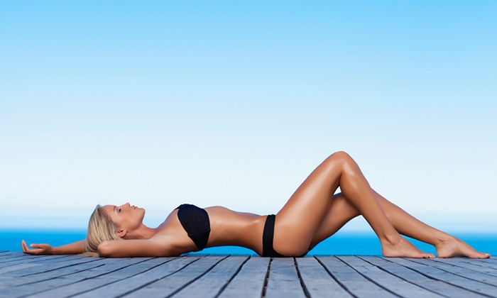 Expand Your Tan - Chicago: Three Spray Tans or Pod Treatments or One Month of Unlimited Tanning at Expand Your Tan (Up to 90% Off)