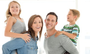 Higgins Family Dental: Cleaning, X-rays, and Exam with Optional Teeth Whitening at Higgins Family Dental (Up to 85% Off)
