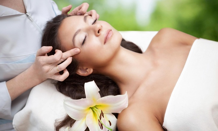 Uptown Holistic Massage - CARAG: 60- or -90 Minute Massage with Reiki or Massage with Foot Scrub at Uptown Holistic Massage (Up to 51% Off)