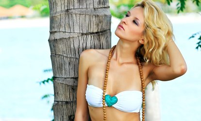 One Month of Unlimited UV <strong>Tanning</strong> or Two Spray Tans at B-Tan (Up to 67% Off)