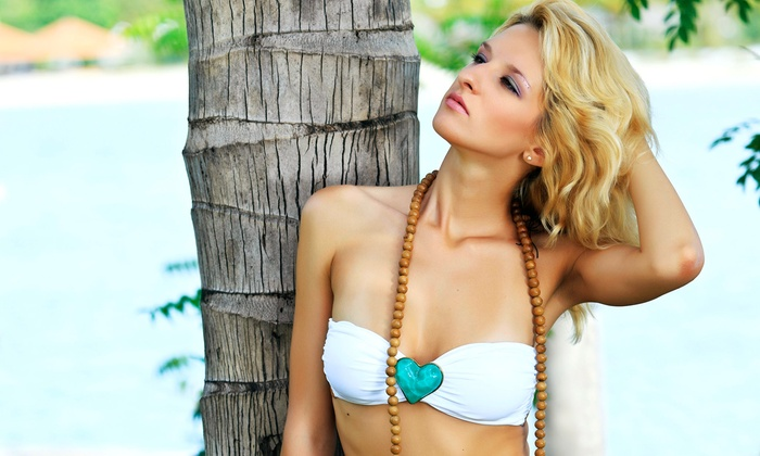 B-Tan - Multiple Locations: One Month of Unlimited UV Tanning or Two Spray Tans at B-Tan (Up to 61% Off)