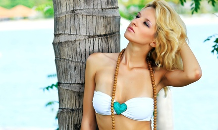 One Month of Unlimited UV Tanning or Two Spray Tans at B-Tan (Up to 61% Off)