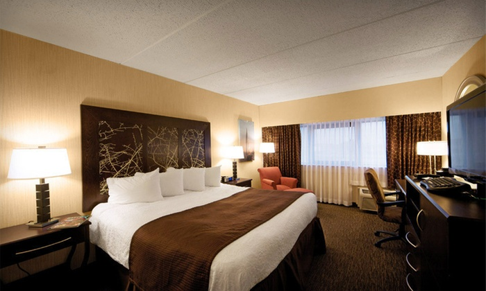 Adam's Mark Buffalo - Buffalo, NY: $99 for a One-Night Stay with Dining and Gaming Credits at Adam's Mark Buffalo in Buffalo, NY