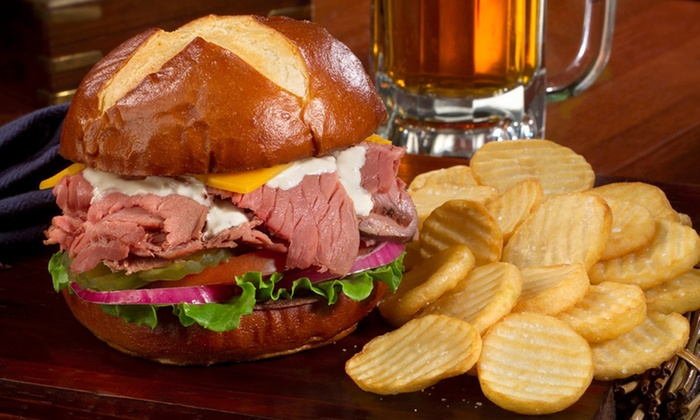 The Lion & Rose British Restaurant & Pub - Multiple Locations: $11 for $20 Worth of British and American Food at The Lion & Rose British Restaurant & Pub