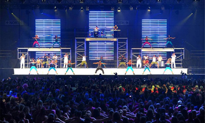Zumba Fitness Concert - Near North Side: Zumba Fitness Concert at Navy Pier Exhibition Hall on Saturday, August 31, at 4 p.m. or 8 p.m. (Up to $60 Value)
