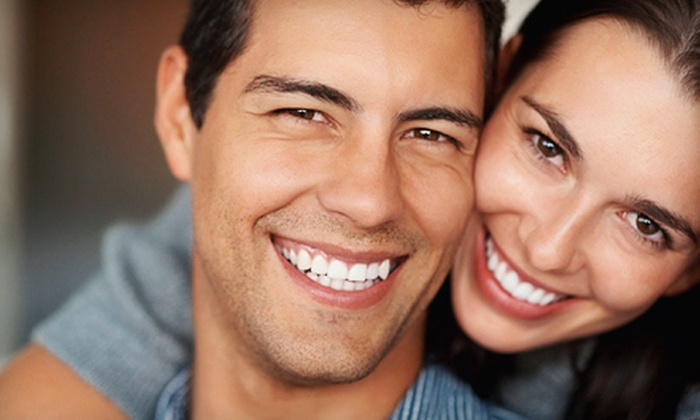 Pro White Teeth Whitening - Mall of Georgia: One Teeth-Whitening Treatment or One Year of Unlimited Treatments at Pro White Teeth Whitening (Up to 87% Off)