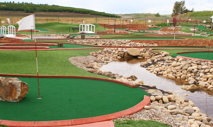 Oasis Greens Golf Centre - Calgary: Round of Mini-Golf for Two Adults or a Family of Four at Oasis Greens Golf Centre (Up to 48% Off)
