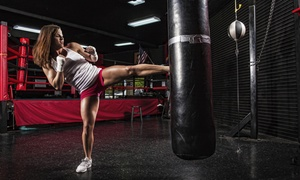 Powerhouse Kickboxing: Group Fitness Classes or One Month of Unlimited Classes and Gym Access at Powerhouse Kickboxing (Up to 75% Off)