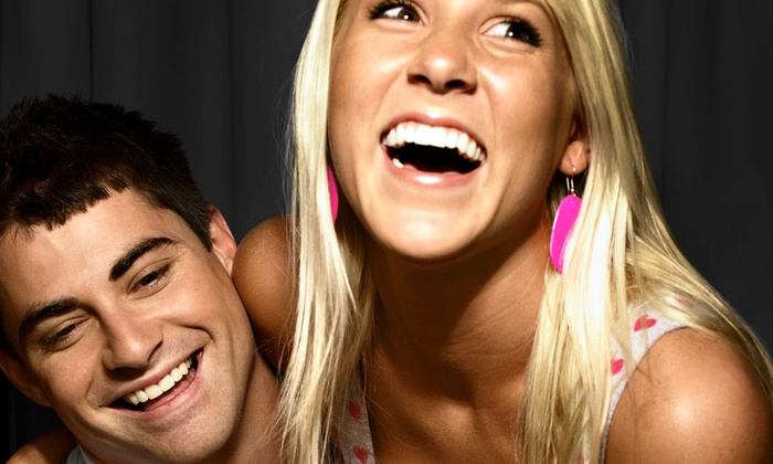 PhotoPro's Photo Booth 3 - Lansing: Two- or Four-Hour Photo-Booth Package from PhotoPro's Photo Booth - Booth 3 (50% Off)