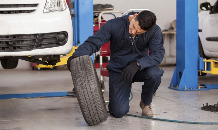 SpeeDee Oil Change - Multiple Locations: Oil Change and Tire Rotation or Cooling System Fluid Exchange at SpeeDee Oil Change (Up to 46% Off)