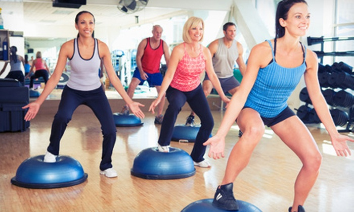 JKM Fitness - Midtown South Central: 20 Yoga, Kickboxing, or Fitness Classes or 10 One-Hour Personal-Training Sessions at JKM Fitness (Up to 90% Off)