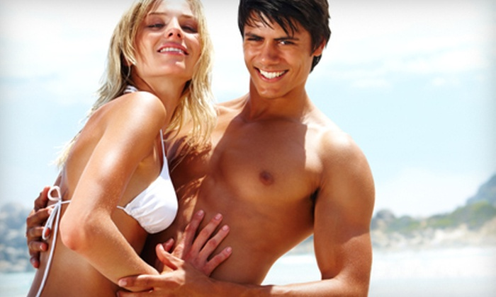 EuniQue Tanning Salon & Spa - Bashas Thunderbird Village: Three Spray Tans or One Month of Unlimited UV Tanning at EuniQue Tanning Salon & Spa (Up to 61% Off)