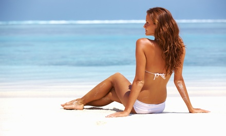 One Month of Unlimited Tanning, or One or Three Spray Tans at Skin Tonz Tanz (Up to 55% Off)