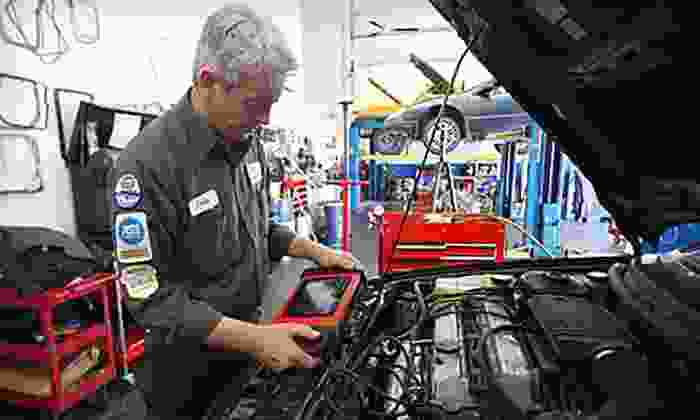 Auto Care Super Saver - Multiple Locations: One Punch Card with Three Oil Changes, Two Tire Rotations, and Other Services from Auto Care Super Saver (Up to 84% Off). Two Card Option Available, Four Locations Available.