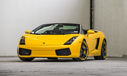 Four-Lap Ride-Along or Driving Experience in a Lamborghini or Ferrari from Cloud 9 Exotics (Up to 60% Off)