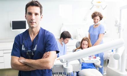Visita e pulizia dei denti più otturazione e sbiancamento LED (sconto fino a 90%)