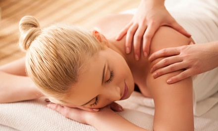 One or Two Groupons, Each Good for a 60-Minute Massage, or a Chiropractic Package at Power Chiropractic (Up to 77% Off)
