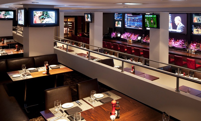 Boomer Esiason's Stadium Grill - Theater District - Times Square: Appetizers and Beer or Cocktails for Two, Four, or Six at Boomer Esiason's Stadium Grill (Up to 56% Off)