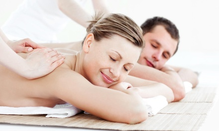 $52 for a Relaxation Spa Package with Massage, Scrub, and Hand Dip at The Oasis Salon & Spa ($120 Value)