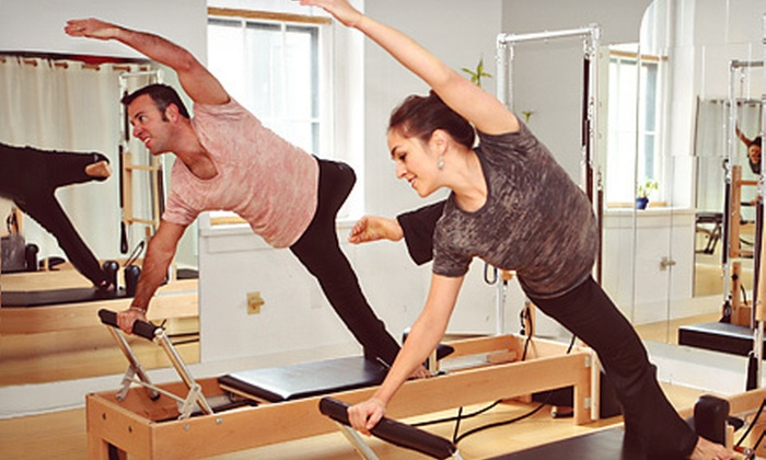 Invoke Yoga and Pilates Studio - Downtown Indianapolis: $49 for One Private Reformer-Pilates Session and Four Quad Reformer Classes at Invoke Yoga and Pilates Studio ($140 Value)