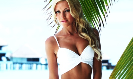 One or Five Venetian Norvell Spray Tans or One Month of Unlimited Bed Tanning at Hollywood Tans (Up to 58% Off)
