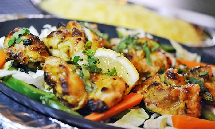 Haldi Indian Cuisine - New York: Calcutta-Style Indian Meal with Appetizers, Entrees, and Wine for 2 or 4 at Haldi Indian Cuisine (Up to 51% Off)