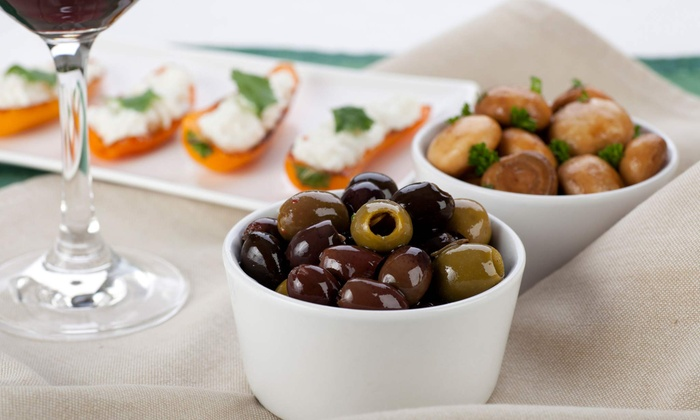Nia Mediterranean Restaurant - West Town: Eight-Course Mediterranean Tapas Menu for Two at Nia Restaurant (27% Off). Groupon Reservation Required.