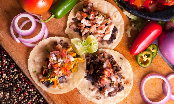 Super Taco Mexican Restaurants - Multiple Locations: Burritos, Tacos, and Combination Plates at Super Taco Mexican Restaurants (40% Off). Two Options Available.