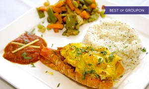 Dhoom: Four-Course Indian Meal for Two or Four at Dhoom Indian Restaurant (Up to 54% Off)