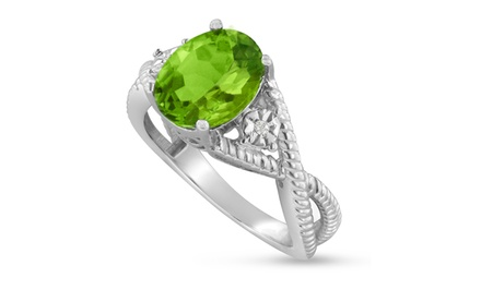 2.85 CT Oval Peridot and 1/100 CTTW Diamond Ring in Sterling Silver