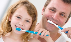 Spring Dental: Child or Adult Dental Care with Cleaning, Exam, and X-rays at Spring Dental (Up to 83% Off)