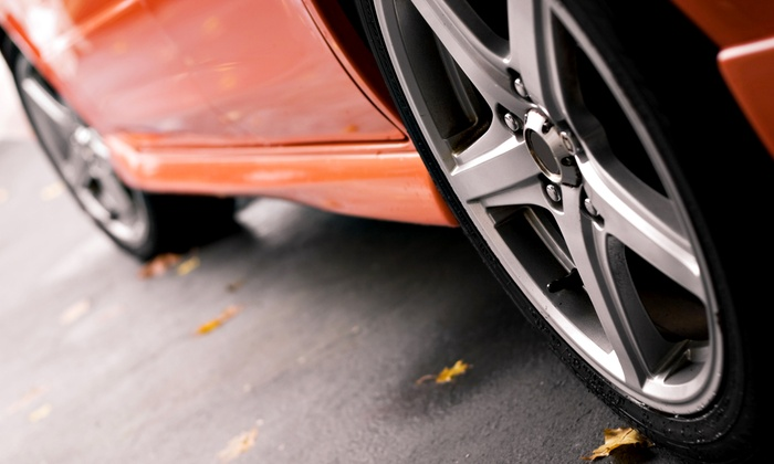 Outlet Mufflers & Tire - Salt Lake City: $65 for All-Wheel Alignment and Front-Wheel Balance at Outlet Mufflers & Tire ($130 Value)