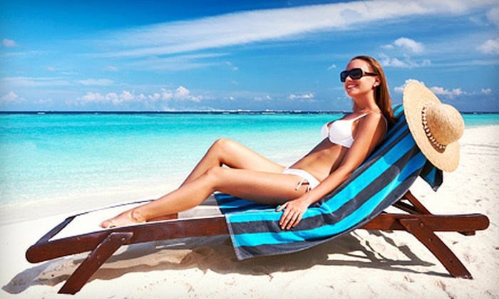 Salon Tropics - Shenandoah: One or Two VersaPro Spray Tans at Salon Tropics (Up to 64% Off)