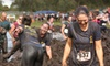 Mud Dogs - Peach Creek Estates: $40 for One 5K or 10K Race Registration to Mud Dogs on Saturday, May 11, and a T-shirt (Up to $80 Value)