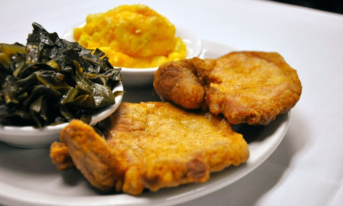 Flood's Bar & Grille - Downtown Detroit: $29 for $50 Worth of American Soul Food and Drinks at Flood's Bar & Grille