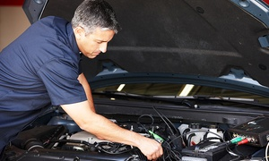 Freins Plus: Rustproofing Treatment, Oil Change or Brake Pad Change at Freins Plus (Up to 73% Off)