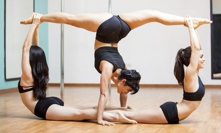 Four Pole Dancing Classes at Pole Felony Fitness (65% Off)