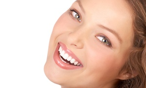 West LA Dental Health Center: Dental Exam and X-rays with Optional Cleaning or Take-Home Whitening Kit at West LA Dental Health Center (Up to 93% Off)