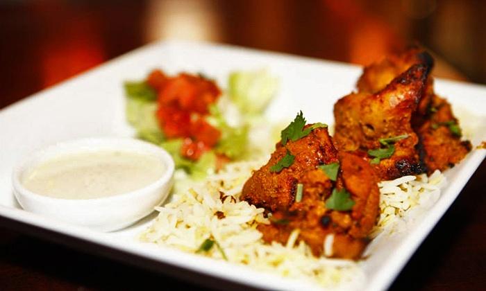Tandoori Grill - Linworth Village: Pakistani Food and Drinks at Tandoori Grill (Half Off). Two Options Available.