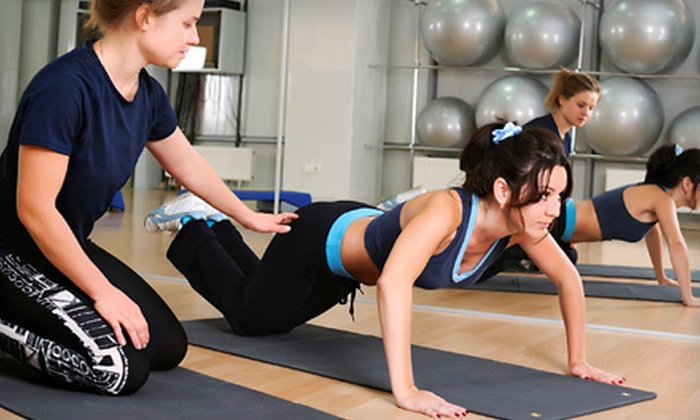 Xclusive's Complete Fitness Center - Southwest Rancho Cucamonga: One Month of Unlimited Training or The Experience Wellness Package at Xclusive's Complete Fitness Center (Up to 69% Off)