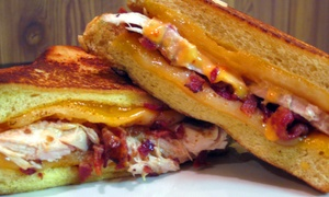 Cheesie's Pub & Grub: Grilled Cheese Sandwiches for Two or Four at Cheesie's Pub & Grub (Up to 45% Off)