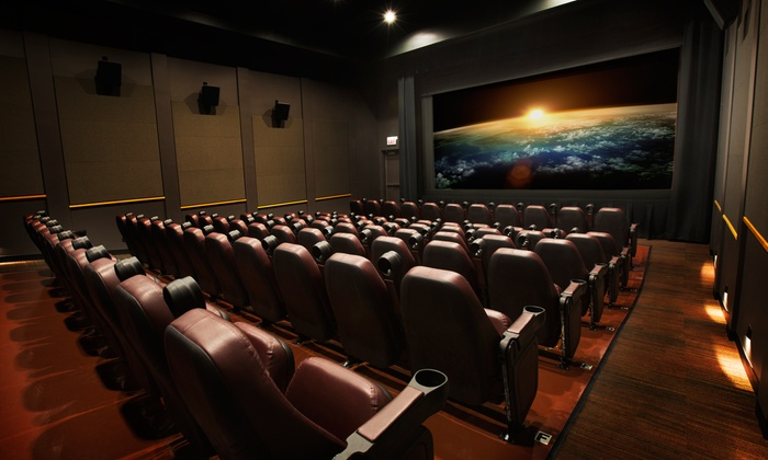 The Harper Theater - Hyde Park: Movie and Popcorn for Two or Four with Sodas or Well Drinks at The Harper Theater (Up to 41% Off). Four Options.