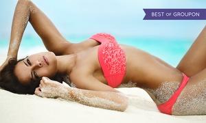 NY Sun Club: Airbrush or UV Tanning at NY Sun Club (Up to 58% Off)