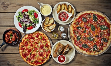 One or Two Groupons, Each Good for $10 Worth of Pizzeria Cuisine at Salvation Pizza
