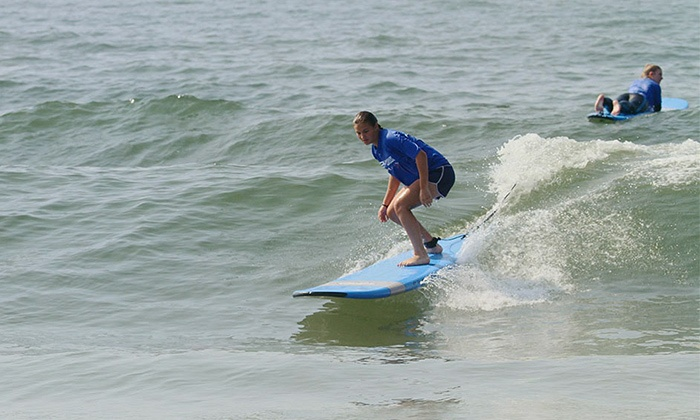 Skudin Surf - Rockaway Beach: $67 for a Surfing and Beach Yoga Class with Surfboard Rental for One at Skudin Surf ($105 Value)