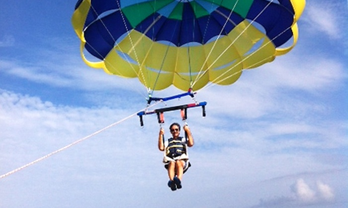 Sky 1 Parasail - Banana  River Park: 800-Foot Parasail with Deluxe Photo Packages for One, Two, or Three at Sky 1 Parasail (Up to 51% Off)