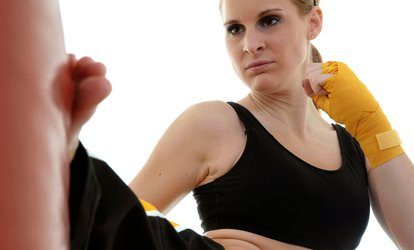 Up to 68% Off One Month of Kickboxing Classes