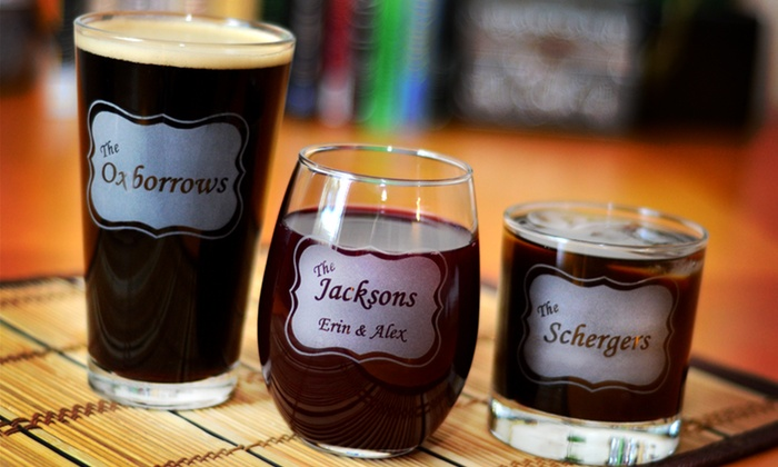 Glass with a Twist: Two or Four Custom Engraved Family-Name Wine, Rocks, or Pint Glasses from Glass with a Twist (Up to 53% Off)