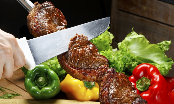 Bertolucci Brazilian Steakhouse - Paradise: All-You-Can-Eat Dinner with wine and dessert for Two or Four at Bertolucci Brazilian Steakhouse (Up to 41% Off)